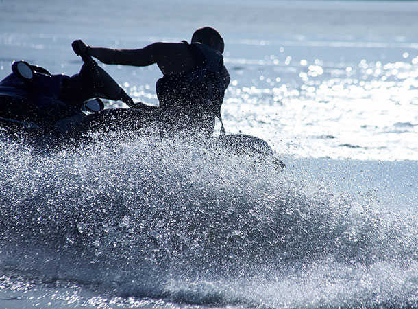 jet skier in silhouette - illustration purposes only