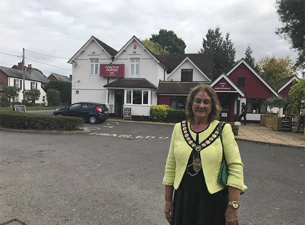 Councillor Christine Ward outside the Coach and Horses