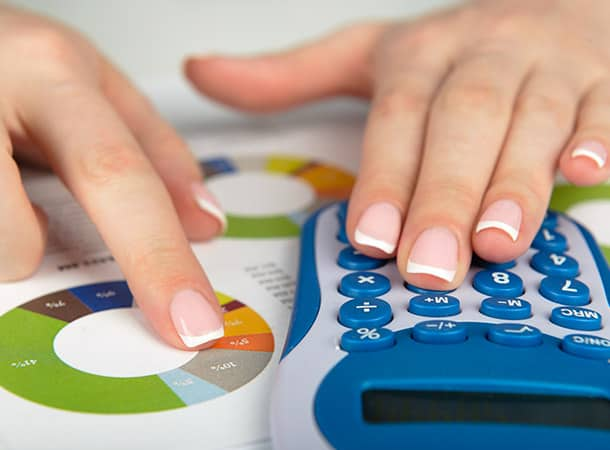 Lady using calculator to work out her council tax
