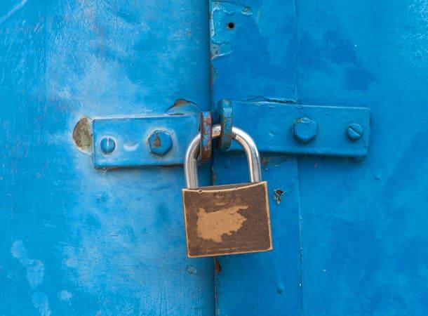 Padlock Lockihng Two Blue Doors