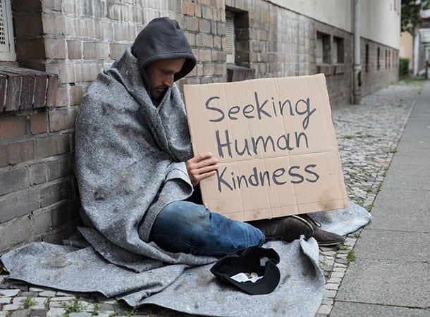 Homeless Person Seeking Human Kindness