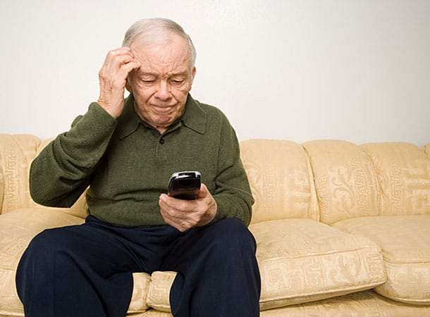 Elderly Man With Phone